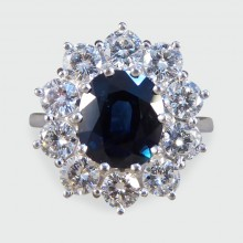 SOLD Contemporary Sapphire and Diamond Cluster ring modeled in 18ct White Gold