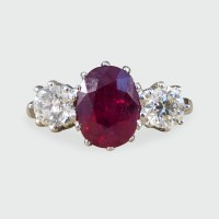Contemporary Oval Ruby and Diamond Three Stone Ring in Platinum