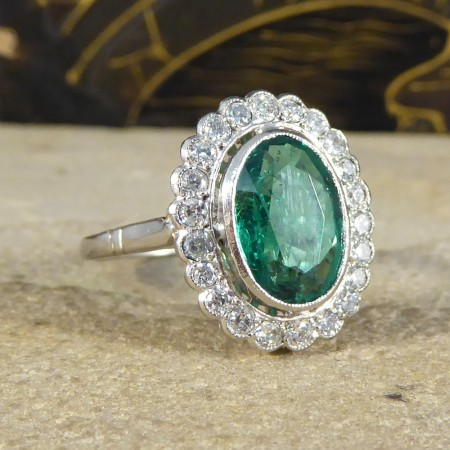 Contemporary Emerald and Diamond Halo Cluster Ring in Platinum