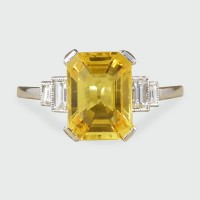 Emerald Cut Yellow Sapphire with Baguette Cut Diamond Shoulders Ring in Platinum
