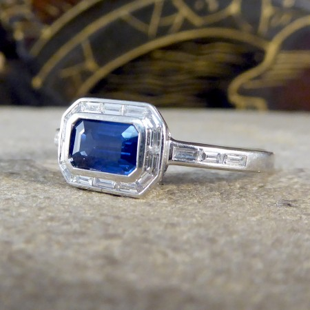 Contemporary Emerald Cut Sapphire and Diamond Cluster Ring in Platinum