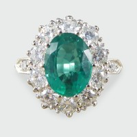 Contemporary 1.30ct Emerald and 2.15ct Diamond Cluster Ring in Platinum