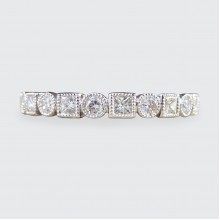 Contemporary Brilliant and Princess Cut Full Eternity Ring in 18ct White Gold