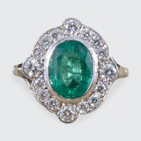 Contemporary Art Deco Style Emerald and Diamond Cluster Ring in Platinum and 18ct White Gold