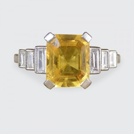 Contemporary Art Deco Style Yellow Sapphire Ring with Baguette Diamond Shoulders in Platinum