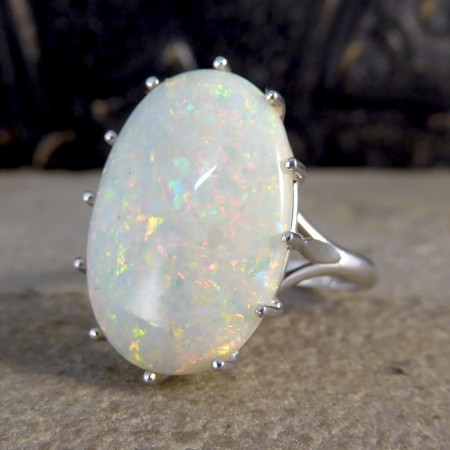 Contemporary Single Oval Colourful Opal Ring in 18ct White Gold